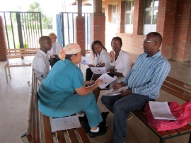 Dr. Washington provides guidance to the Rwandan medical student and resident team.