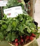 Beautiful radishes and other veggies await you at the farmers market.