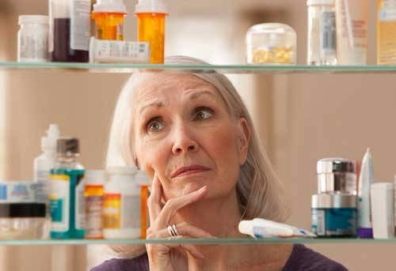 Woman.and.medicine.cabinet