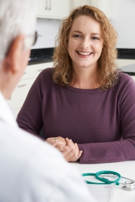 Plus Size Woman Meeting With Doctor In Surgery