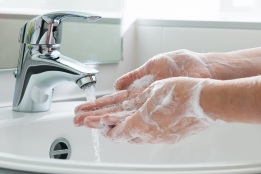 Washing hands helps prevent the spread of viruses like COVID-19.